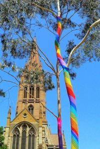 Yarn bombed tree in front of Melbourne Cathedral
